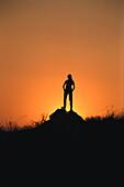 Woman watching Sundown, South Afrika