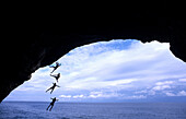Free climber jumping into sea, Mallorca, Spain