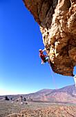 Male rock climber, Las Canadas, Tenerife, Canary Islands, Spain