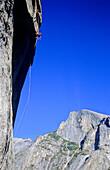 man sbseiling above South West Face, Big Wall Climbing, Washington Column, Yosemite Valley, California, USA