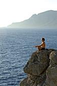 Yoga on cliff line of Kalymnos, Kalymnos, Greece