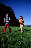 Couple wandering on meadow neutral location, , Muehlviertel, Upper Austria