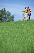 Young couple kissing on meadow, Muehlviertel, Upper Austria