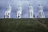 People in front of big sculptures, Esbjerg, Juetland, Denmark, Europe