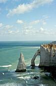 View of chalk cliffs on shore, Etretat Cliffs, Etretat, Normandy, France, Europe