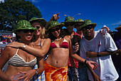 Young people wearing party hats partying on the beach, Crop-Over Festival, Bridgestone, St. Michael, Barbados, Caribbean