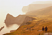 Hikers on the coastal track, Near Durdle Door, West Lulworth, Dorset, England, Great Britain
