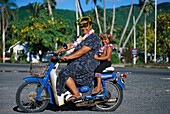 Woman and child on a moped, Avaruna, Rarotonga, Cook Islands, South Pacific