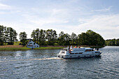 Houseboat & Lakeside House, Houseboat and lakeside house, Crown Blue Line Grand Classique Houseboat, Lake Canower See, Mecklenburgian Lake District, Germany