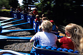 Children on Lego Carousel, Legoland, Billund, Central Jutland, Denmark