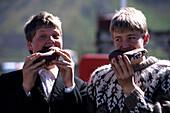 Boys enjoying Pastries, Ísafjörður, Isafj'rdur, Ísafjarðarbær, Iceland