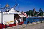 Fishmonger selling fish rolls, Roebel, Mecklenburg Lake district, Mecklenburg-Vorpommern, Germany