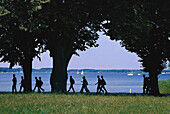 People walking around lake Muritz, Mecklenburg Lake District, Mecklenburg Western Pomerania, Germany