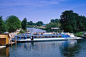 Tourboat at landing stage, canal near Plau, Mecklenburg Lake District, Mecklenburg-Western Pomerania, Germany