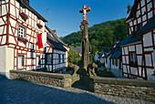 Elzbach bridge and half timbered houses in Monreal, Eifel, North Rhine-Westphalia, Germany
