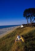 Two women admiring the view, Beach near Ahrenshoop, Fischland Darss Zingst, Mecklenburg- Vorpommern, Germany