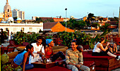 Laughing people on the terrace of the Cafe del Mar, Cartagena de Indias, Colombia, South America