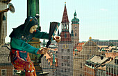 Glockenspiel am Rathausturm, Juggler figure at Town Hall Tower carillon, Marienplatz, Munich, Bavaria, Germany, Chiming Clock in the New Town Hall, Colored Dancers and Knights act out an event of Munich´s Past – the tounament held on Marienplatz in 1568 f