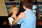 Kathrein dance, young couple dancing at Loewenbraeukeller, Munich, Bavaria, Germany, Europe
