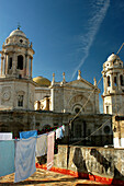 Clothesline with washing in front of the Cathedral of Cádiz, Cadiz, Andalucia, Spain
