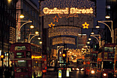 Christmas lights above Oxford Street in the evening, London, England, Great Britain, Europe