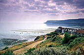 View at coast area under clouded sky, Robin Hood's Bay, Yorkshire, England, Great Britain, Europe