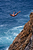 Cliff diver during jump, Acapulco, Guerrero, Mexico, America