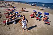 Lifeguard and people on sunloungers on the beach, Rimini, Adriatic Coast, Italy, Europe