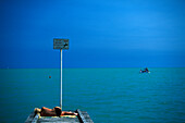 A person on a jetty on the waterfront, Lido di Jesolo, Veneto, Italy, Europe
