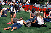 People relaxing at St. Stephen' s Green park, Dublin, Ireland, Europe