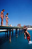 Young people on the wooden footbridge, Hotel Xanadu, Belek, Turkish Riviera, Turkey