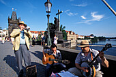 Musicians on Charles Bridge in the sunlight, Prague, Czechia, Europe