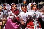 Puppets in traditional costumes at Havelske Street Market, Prague, Czechia, Europe