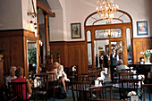 People at the cafe of the Pariz hotel, Prague, Czechia, Europe