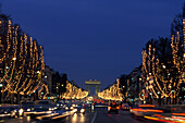 View of Arc de Triomphe and christmas lights at Champs Elysees in the evening, Paris, France, Europe