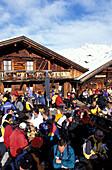 Gampe Alp, people sitting outside a ski hut, Soelden, Oetztal, Tyrol, Austria