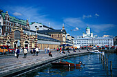 People in front of Kauppahalli market hall at harbour, Helsinki, Finland, Europe