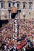 Castellers, human tower at the Festa de la Merce, Placa St. Jaume, Barcelona, Catalonia, Spain