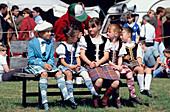 Highland Fling Dancer on park bench, Glenfinnan Highland Games Ivernesshire, Scotland, United Kingdom