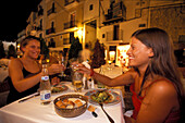 Two young women eating dinner in Restaurant La Oliva, Dalt Vila, Ibiza Stadt, Ibiza, Balearic Islands, Spain