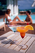 A couple sat behind a refreshing cocktail at the pool of Casa Colonial Beach and Spa, the Playa Dorada, Puerto Plata, Dominican Republic, Caribbean