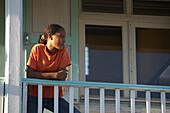 Girl, Watching, Balcony, Carnival, Le Moule, A girl is watching from the the balcony to the Carnival, Grande-Terre, Guadeloupe, Caribbean Sea, America