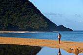 Man, Beach, Seascape, Walking, Man is walking along the beach Grande-Anse Beach, Deshaies, Basse-Terre, Guadeloupe, Caribbean Sea, America