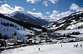 Skiers on a ski slope, Saalbach, Salzburger Land, Austria, Europe