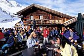 People in front of a ski hut, Gampe alp, Soelden, Oetz Valley, Tyrol, Austria, Europe