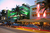 Cars and illuminated buildings at night, Ocean Drive, South Beach, Miami, Florida, USA, America
