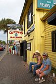 Two men in front of Captain Tony's Saloon, the supposingly original Sloppy Joe's Bar Key West, Florida, USA