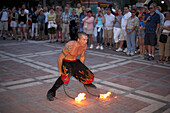 Fire artist at the Daily Sunset Celebrations, Mallory Square, Key West Florida, USA