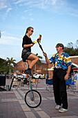 Acrobat on a bike at Daily Sunset Celebrations, Mallory Square, Key West Florida, USA
