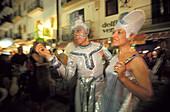 Partygoers in futuristic fancy dress, C Garijo, Ibiza Stadt, Sa Penya, Ibiza, Balearic Islands, Spain